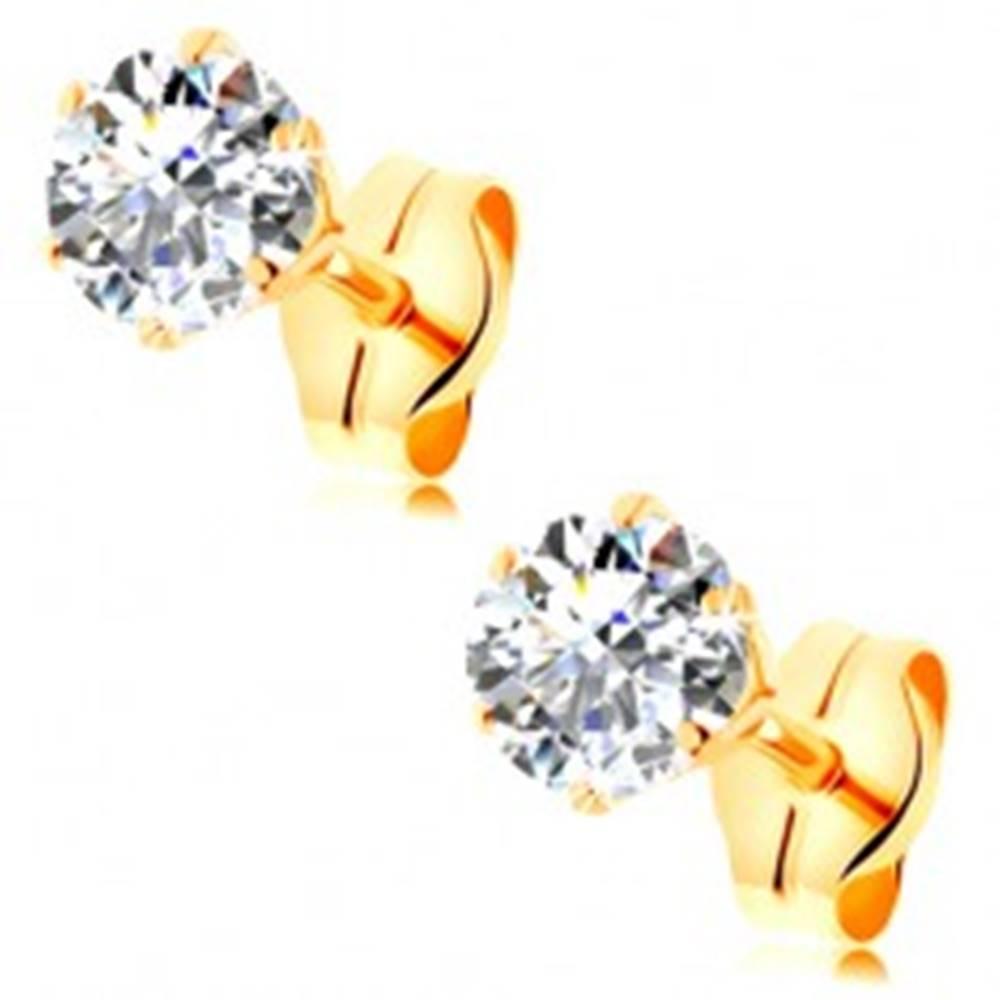 Šperky eshop Náušnice zo žltého 14K zlata - číry okrúhly zirkón v kotlíku, 4 mm