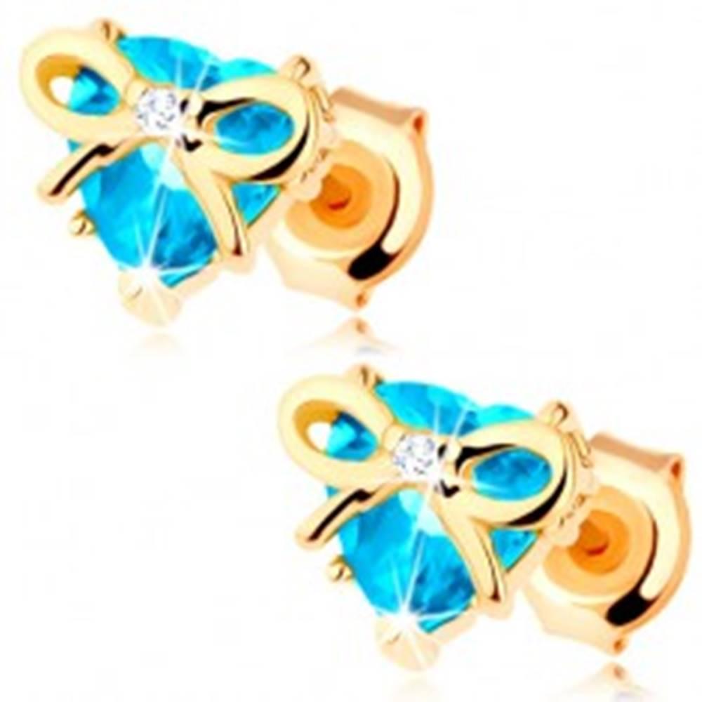 Šperky eshop Náušnice v žltom 9K zlate - vybrúsené topásové srdce, tenká mašľa, zirkónik