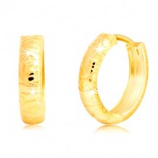 Zlaté náušnice 585 - okrúhle, s plytkými nepravidelnými zárezmi