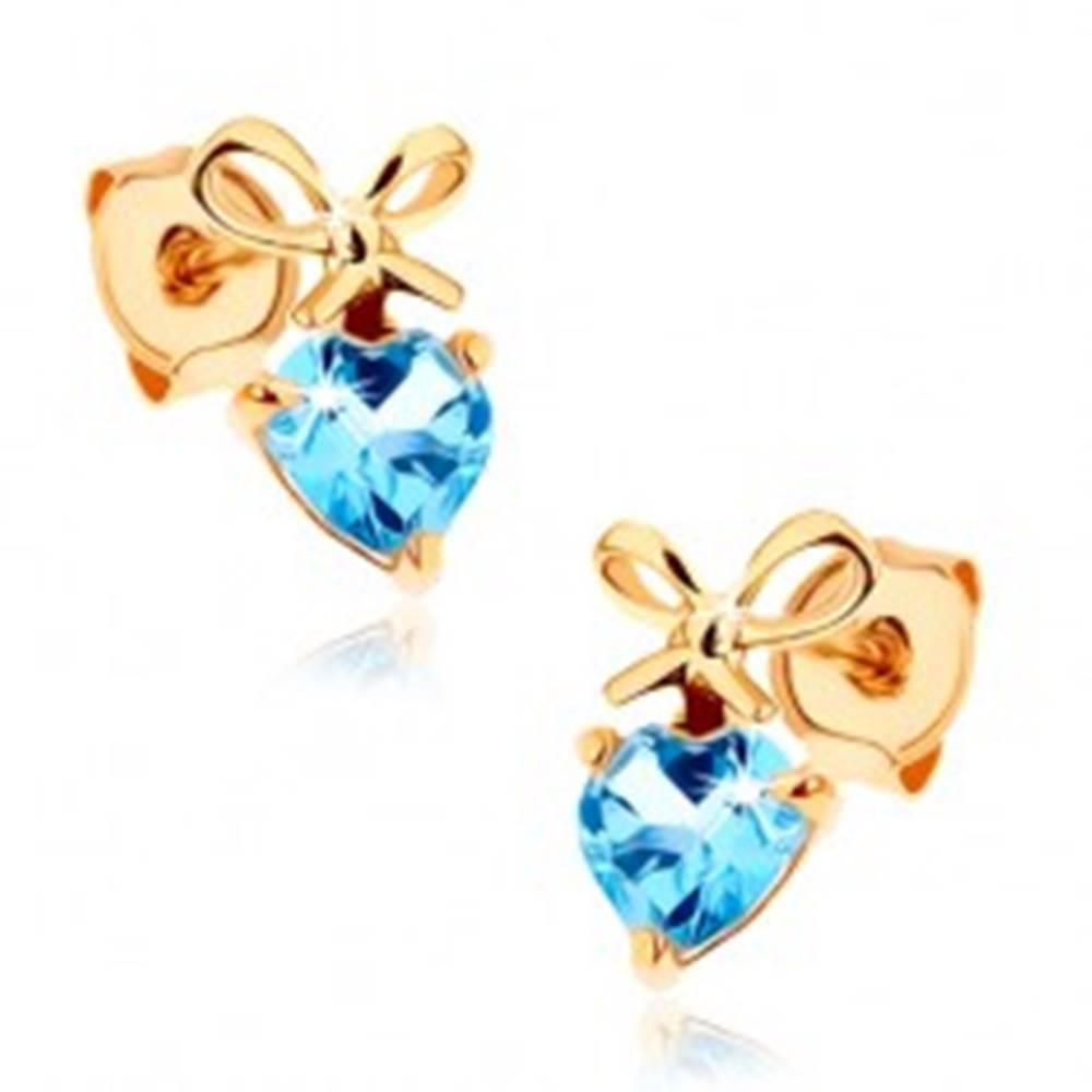 Šperky eshop Náušnice v žltom 14K zlate - modré topásové srdiečko s uviazanou mašľou