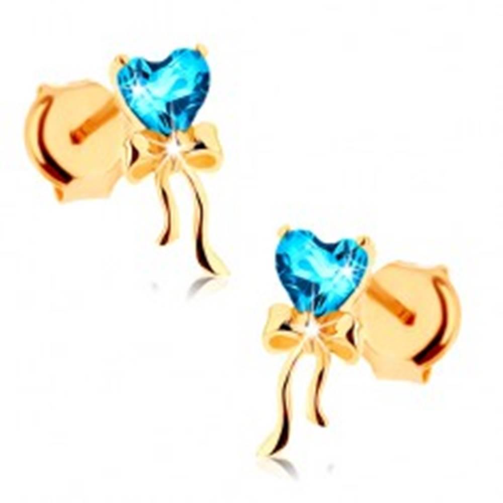 Šperky eshop Zlaté náušnice 585 - lesklá mašlička, modré topásové srdiečko