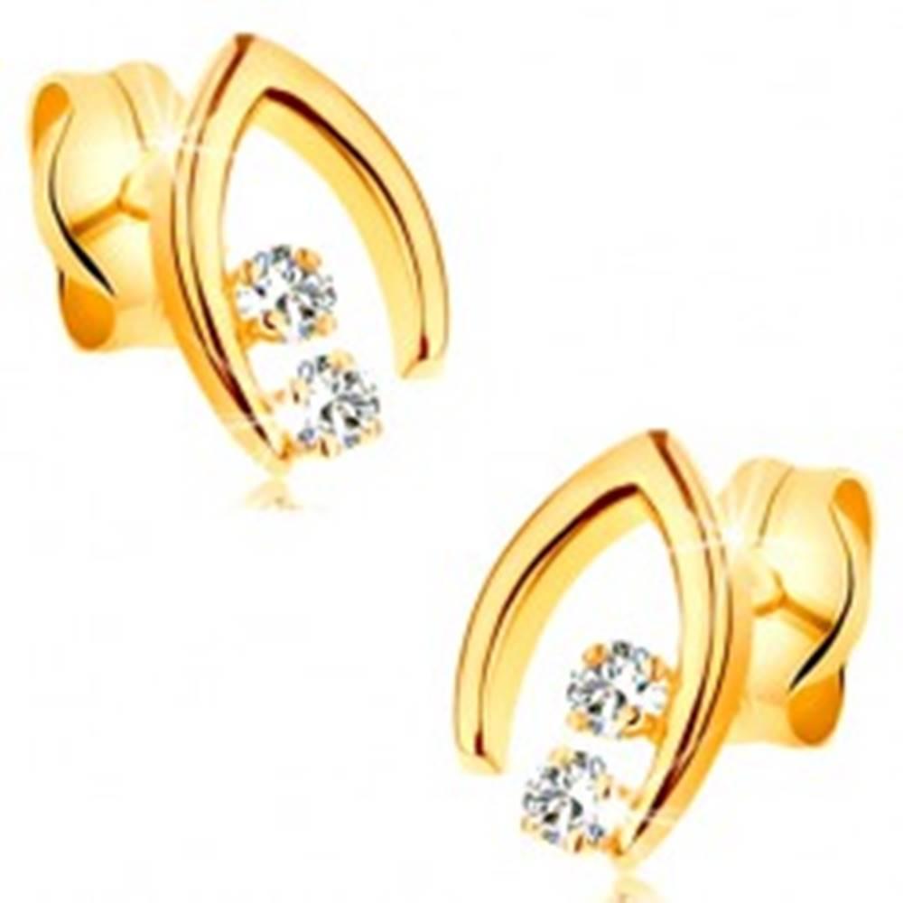 Šperky eshop Diamantové náušnice v žltom 14K zlate - dvojica briliantov v špicatej podkovičke