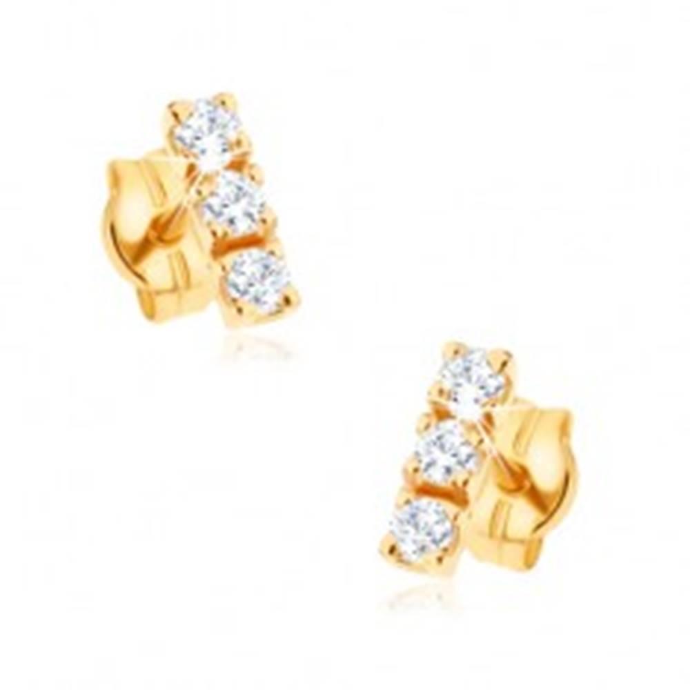 Šperky eshop Zlaté puzetové náušnice 375 - zvislá línia troch zirkónov čírej farby