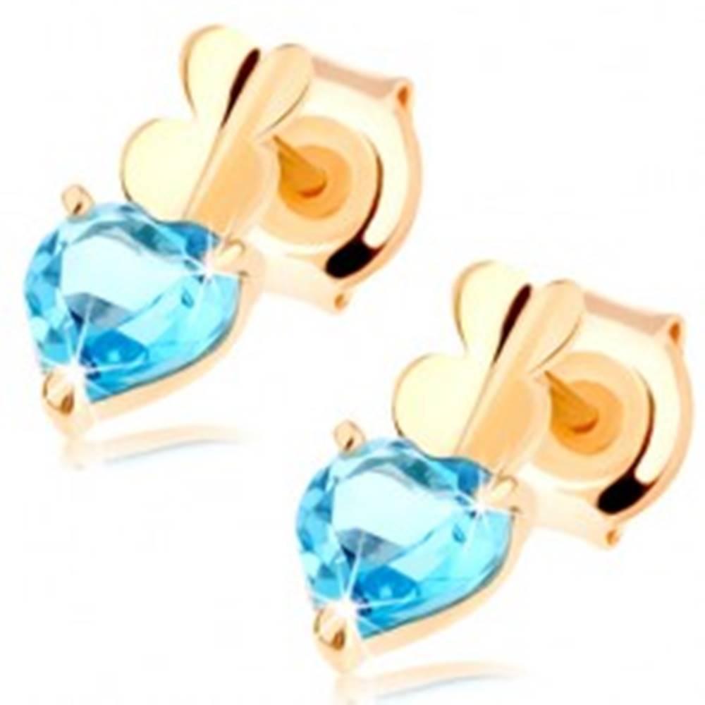 Šperky eshop Zlaté náušnice 585 - dve malé srdiečka a srdiečkový topás modrej farby