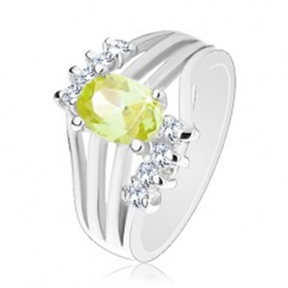 Šperky eshop Ligotavý prsteň striebornej farby, farebný oválny zirkón, lesklé pásy, číre zirkóny - Veľkosť: 50 mm, Farba: Žltá