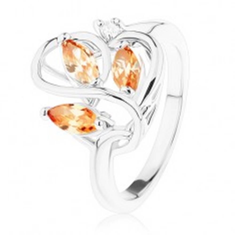 Šperky eshop Ligotavý prsteň striebornej farby, zvlnené línie, oranžové zirkóny - Veľkosť: 53 mm