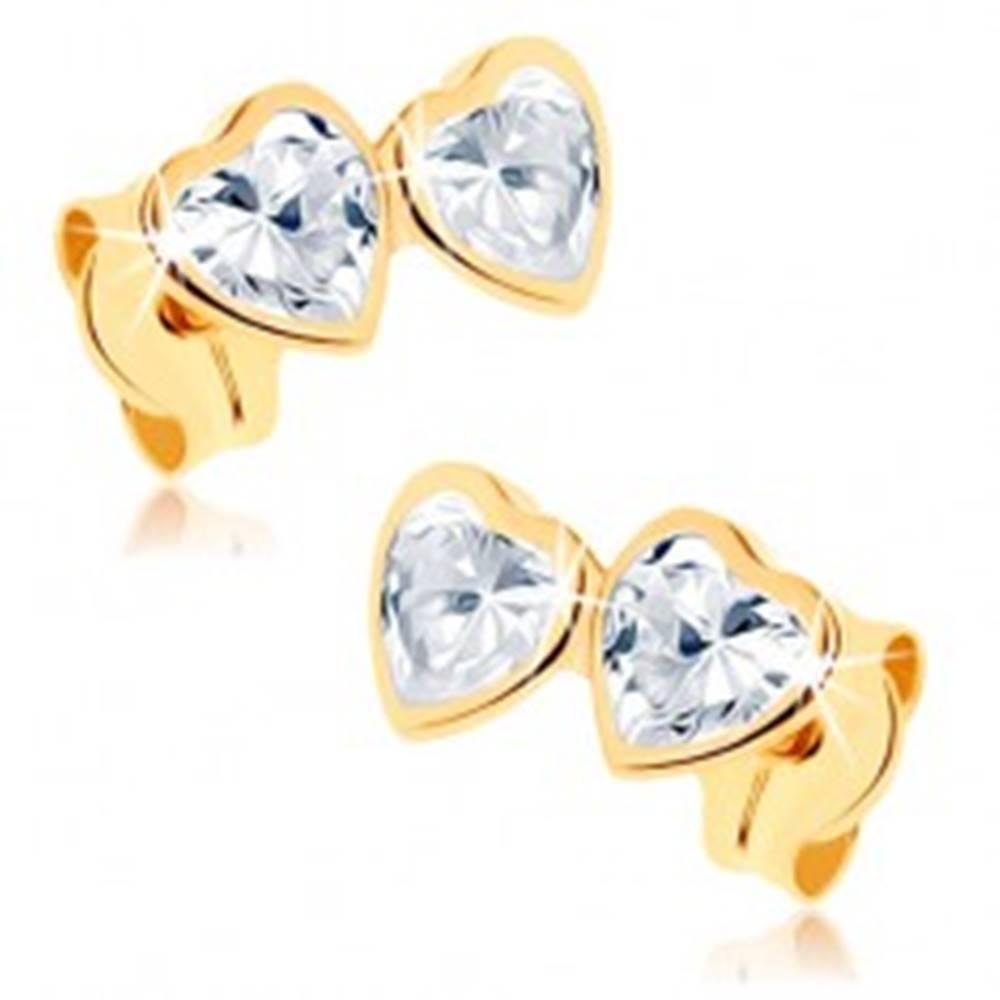 Šperky eshop Zlaté náušnice 375 - dve zirkónové srdiečka čírej farby v objímkach