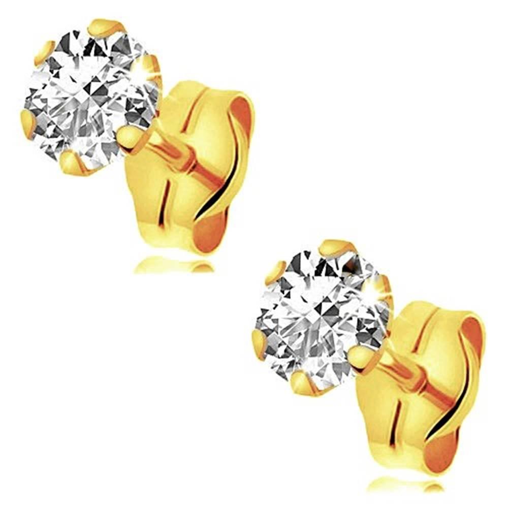 Šperky eshop Zlaté náušnice 375 - okrúhly trblietavý zirkón čírej farby v kotlíku, 4 mm